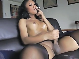 Super sexy Thai ladyboy smoking and shoots her cum.