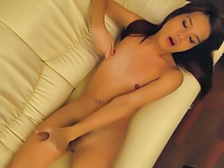 Sweet Asian ladyboy in a solo show.