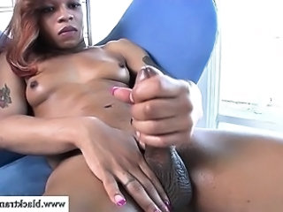 Nubian tgirl cums after tugging herself