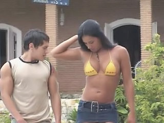 Tall Brazilian shemale fucking with a guy on the porch
