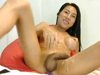Sexy Lengthy Legged Asian Lady Strokes Her Cock & Cums
