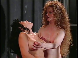 Longhaired brunette gets doggy style from curly haired tranny
