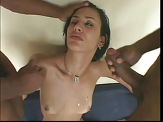 Sexy she-creature with small tits disrobes and strokes her cock