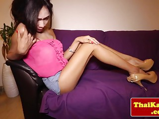 Thai ladyboy wanks off and gets ass fingered