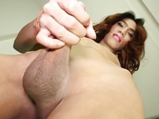 July Shemale strokes her cock