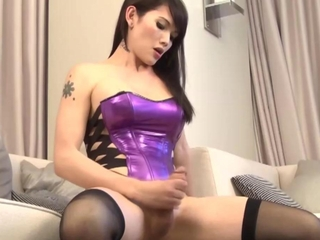 Shemale solo with her hard cock tugging away at it