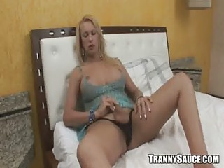 Sexy blonde shemale stripping and tugging on her cock