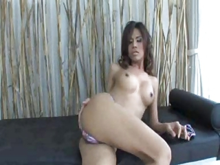 Asian shemale jerks off her big cock and cums