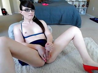 Shemale Wearing Glasses Jerks and Dribbles Cum