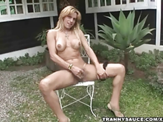 Blonde shemale bombshell tugging off while outdoors